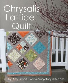 Large Chrysalis Lattice Quilt « Moda Bake Shop. Amy Smart Design using 1 layer cake and 1 charm pack.