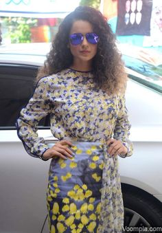 Kangana Ranaut wearing a floral printed dress by Prabal Gurung and blue aviator style sunglasses. via Voompla.com