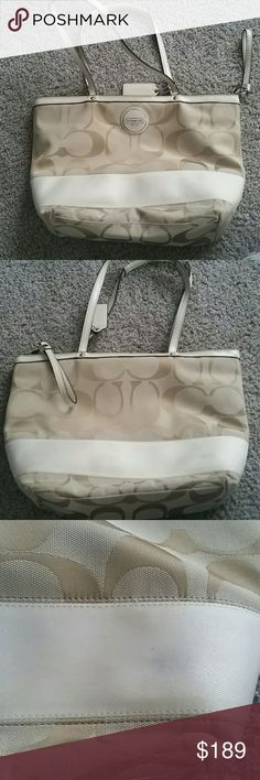 Coach cream signature stripe tote Great used condition. Small mark as shown on back side. Only used a couple of times. Great for spring/summer! Coach Bags Totes