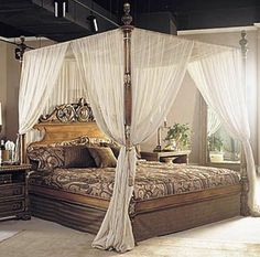 wooden canopy bed with white curtains : hang curtains in a canopy
