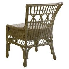 """Showcasing a woven wicker design, this lovely accent chair brings a touch of coastal inspiration to your sunroom or foyer.  Product: ChairConstruction Material: Poplar wood veneers, hardwood, foam, cotton and wickerColor: Distressed beigeFeatures:Part of the Paula Deen Home CollectionCushion includedOpenwork woven designDimensions: 37"""" H x 26"""" W x 27"""" D"""