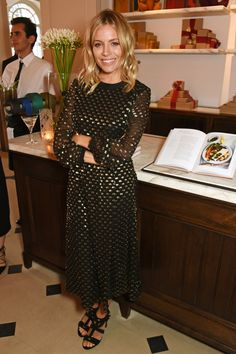 21 June Sienna Miller looked stunning in a black-and-gold polka-dot dress by Burbery for the launch of Wendy Rowe's new book, Eat Beautiful in London. - HarpersBAZAAR.co.uk