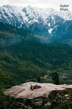 Young girl relaxing on Rock ,at Kullu valley Manali Himachal Pradesh India