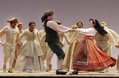"""Roxana Constantinescu, right, as Zerlina and Joshua Bloom as Masetto with the cast in the dress rehearsal of \""""Don Giovanni\"""" presented by Los Angeles Opera at the Dorothy Chandler Pavilion in Los Angeles. Review: L.A. Opera's 'Don Giovanni' upholds tradition expertly 