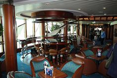 Schooner Bar (Deck Royal Caribbean's trademark Schooner Bar is decorated with sails and wood fashioned to look like the ribbed hull of a ship. You can sink into comfy sofas here or hang at the bar. Caribbean Cruise, Royal Caribbean, Jewel Of The Seas, Comfy Sofa, Cruise Port, Barbados, Sailing, Jewels, Cruises