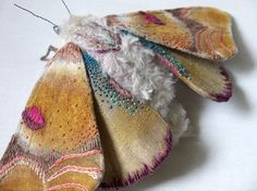 Yumi Okita This moth is about 5 inch tall and 10 1/2 inch wide. The wings are made from cotton fabric and the body is made from fake fur. It is hand painted and