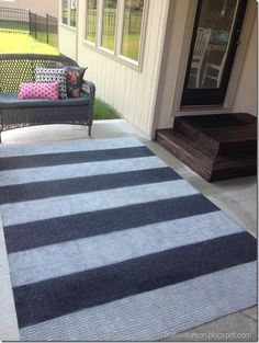 DIY Spray Painted Outdoor Rug- great for the porch or patio!