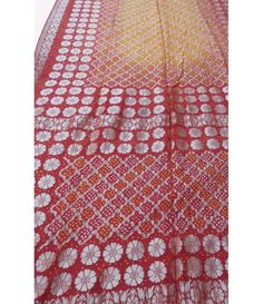 Red Orange Georgette Banarasi Bandhani Saree-----We bet you will never have enough of Bandhanis as they are versatile and you will definitely look different every time you wear one. Bandhani is a must have traditional Indian clothing for the rooted and cultured woman of today.------Sarees from luxurionworld.com