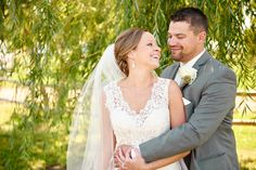 Minnesota Harvest Apple Orchard Wedding walking under the trees with love in their eyes