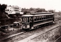 Mt. Tabor Streetcar #438 is shown making a Sunnyside run Taken circa 1905-1910, near what is now SE 65th Ave., and Belmont in Portland   The Massachusetts Building (left rear) was moved, piece by piece, to what is now about 65th & Belmont after the Lewis & Clark Exposition ended in 1905.  The Mt. Tabor visitor center would today be up just a bit behind where the house was