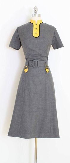 ➳ vintage 1950s dress * fabulous color combo! * heather gray wool blend * fully lined in acetate * metal back zipper * yellow organza details * detachable belt condition | excellent fits like m/l length 45 bodice 18 bust 38-40 waist 29-30 hips 42 ➳ shop http://www.etsy.com/shop/millstreetvintage?ref=si_shop ➳ shop policies http://www.etsy.com/shop/millstreetvintage/policy twitter | MillStVintage facebook | millstreetvintage instagram...