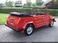 red vw thing convertible