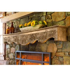 This floor to ceiling kitchen fireplace was designed with misty bay hand carved wood pine cone mantel susan want solutioingenieria Image collections