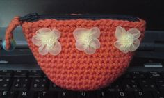 coin purse embillished with burgundy flowers