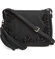 Hand-stitched jet-black beads add just the right amount of shimmer to this gorgeous Kate Spade bag, while laser-cut whipstitched trim beautifully frames the embellished exterior.