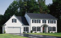 Charter Oak shown in glacier white clapboard with platinum grey dental molding and trim accents and black louvered shutters