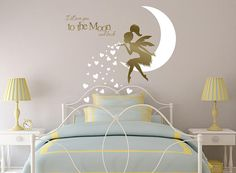 Our newest Fairy Wall Decal with Blowing Heart Kisses with the saying, I Love you to the Moon and Back This whimsical fairy wall decor will add a charming and loving touch as the beautiful pony tailed fairy perched on the moon gently blows kisses over your little ones bed or crib. The fairy & moon will cover approx. 58 wide x 38 tall when your decal is applied as shown but you can arrange it 100% to your liking! This decal will be produced and shipped within 24 hours! CHOOSE YOUR COLOR: ...