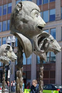 12 gigantic bronze animal heads representing the signs of the Zodiac by Chinese artist Ai Weiwei, stand in a circle on the Rose Kennedy Greenway in Boston. Photo: Bill Sikes