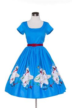 Pinup Couture Mary Dress in Mary Blair Planes Border Print