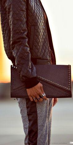 Street style - Kzeniya asymmetric clutch with spikes.. that's totally a guy's hand.. LOL. hot bag tho!