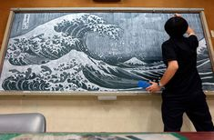 Teacher Hirotaka Hamasaki captivates his young students by drawing sprawling masterpieces on the blackboard.