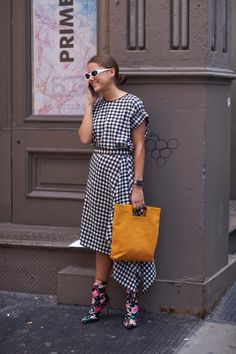 Gingham dress and floral boots.
