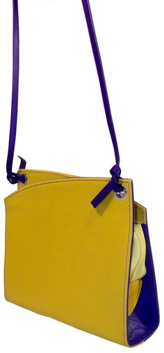 Description Gentle curves, reminiscent of billowing clouds, outline this delightful color blocked mini bag. Fashion meets function with this bag's detachable shoulder strap and zip closure with an inn