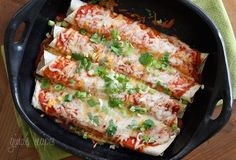 Cheesy Zucchini Enchiladas - These cheesy meatless enchiladas are delicious, packed with fiber so they are filling and easy to make – vegetarian or not. Perfect topped with chopped cilantro, scallions or jalapeños and some low fat sour cream.