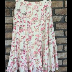 """Flowered Skirt Soo Pretty!! This is a creamy winter-white Skirt with flowers. Has panels and extra panels at the bottom for a fuller look. Has side zipper with clasp and button closure. Elastic in the back of waist for a comfortable fit. It Fully lined. Material is 58% Linen 42% Rayon. Length is Approx 30"""" ... skirt is well made and nice heavier material. In like New Condition. Coldwater Creek Skirts"""