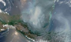 April 26, 2003: In an image from NASA's Aqua satellite, wildfires, as well as fires from slash-and-burn deforestation, raged across Mexico's Yucatán Peninsula and neighboring Guatemala, sending dense plumes of smoke across the Gulf of Mexico. Jeff Schmaltz, Lucian Plesea, Modis Land Rapid Response team/NASA Goddard Space Flight Center