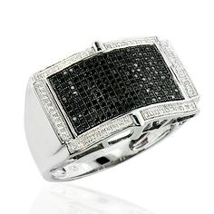 This Fabulous White and Black Diamond Ring for Men in Sterling Silver showcases 0.70 carats of round diamonds and a luxurious rhodium plating for extra shine. This men's silver diamond ring is an affordable alternative to expensive gold jewelry.