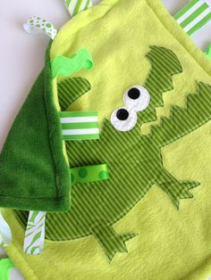 Minky Fleece Tag Blanket Alligator, Crocodile in Green. $25.00, via Etsy.