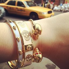 Alexander McQueen bracelets. (I'm not crazy about the one closest to the hand... skulls are a bit too big for my taste.)