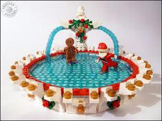 Hi everyone, Here is my entry for the Expand the Winter Village Contest V - the Christmas frozen fountain : A lovely place for Santa and Gingerbread Man to. Lego Christmas Village, Lego Winter Village, Gingerbread Christmas Decor, Christmas Fun, Gingerbread Man, Lego Hacks, Best Lego Sets, Lego Club, Lego Pictures