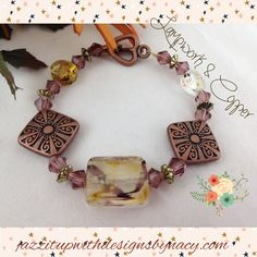 #cpromo Bracelet: Handmade Crystal Lamp work Copper Metal Cranberry Swarovski. Stunning translucent Lampwork glass beads with streaks of brown, gold and beige are surrounded by Cranberry Swarovski Crystals and brass metal beads to make a very beautiful harvest earth tone colored bracelet. Copper metal decorative beads accentuate all the colors within the other beads. Delicate copper heart shaped toggle clasp adds to the look of this beautiful handmade beaded bracelet.