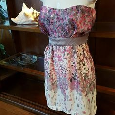 """Body Central Spring flowers dress Beautiful Spring/Summer dress. Different shades of pink and greys. Size cut out. I'm guessing a small or medium.  25"""" long, 15"""" from armpit to armpit. Body Central Dresses Midi"""