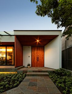 garden house with garage / works / moKA建築工房 Modern Entrance Door, Modern Entry, House Entrance, Entrance Doors, Modern Exterior, Exterior Design, Interior And Exterior, Painted Brick Exteriors, Street House