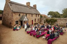 Outdoor wedding ceremony - Image by Matt Parry Photography - Outdoor bohemian Jersey Wedding at the country life museum with bright flowers paper moms and streamers as decor