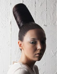 A long brown straight sculptured updo bun avant garde hairstyle by Mieka Hairdressing