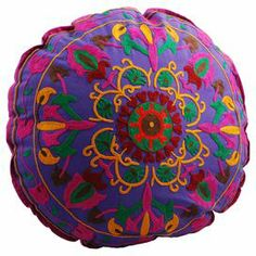 "Cotton floor pillow in purple with a hand-embroidered crewel work.    Product: Floor pillow Construction Material: Cotton cover and  polyester fill Color: Multi  Features: Hand-embroidered  Insert included Dimensions: 22"" Diameter  Cleaning and Care: Dry clean only"