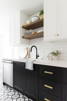 One trick for making your kitchen feel larger that requires zero additional square footage — break up your upper cabinets with open shelving! Not only does it give you a fun place for styling, but it Kitchen Decor, Kitchen Inspirations, Interior Design Kitchen, Kitchen Cabinet Design, New Kitchen, Kitchen Cabinet Styles, Kitchen Remodel, Kitchen Renovation, Trendy Kitchen