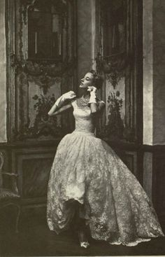 1954 slim short white lace evening dress with billowing long overskirt by Givenchy,