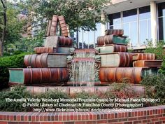 STACKED BOOKS WATERFALL. The Amelia Valerio Weinberg Memorial Fountain (1990) by Michael Fasca (Sculptor). © Public Library of Cincinnati & Hamilton County (Photographer) via flickr. 800 Vine Street, CINCINNATI, OHIO, USA ... Respect people, Respect copyright. Credit the artist. Link directly to the artist's website. COPYRIGHT LAW REQUIREMENTS: http://pinterest.com/pin/86975836525792650/ HOW TO FIND the ORIGINAL WEB SITE of an image: http://pinterest.com/pin/86975836525507659/