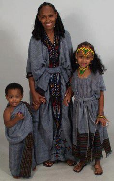 Oromo woman and two kids, Walloo, North Oromia, East Africa