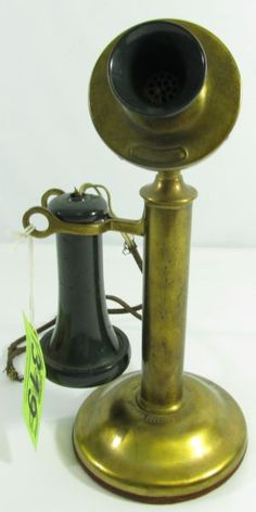 """Lovely vintage brass Western Electric Company candlestick or """"upright desk stand"""" telephone in good condition. This standard candlestick phone included a base, stem, mouthpiece, and receiver. It has a plastic or Bakelite receiver stamped """"Pat in USA, 1900 Mar 26 1901"""" and """"Western Electric Company 143 AW""""."""