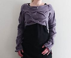 Aran weight cropped knit sweater knitting pattern on Ravelry: Twisting Shadows pattern  Warm, thick and chunky. Wrapped front, asymmetric pullover, easy to knit and follow! Long sleeves, cozy and hygge!
