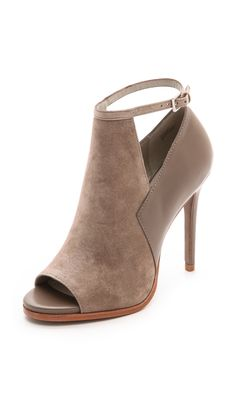 Geometric cutouts divide suede and leather panels on open-toe Pour La Victoire booties. A buckle secures the slender ankle strap. Covered heel and leather sole. Women's Shoes, Hot Shoes, Me Too Shoes, Dream Shoes, Crazy Shoes, Pretty Shoes, Beautiful Shoes, Stilettos, Pumps Heels