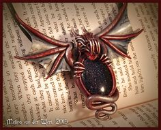 Polymer clay dragon on goldstone by Mel's Creations