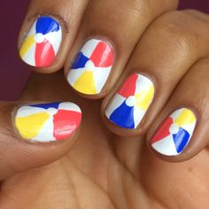 Beach Ball nail art with Sally Hansen Xtreme Wear Coral Reef, Mellow Yellow, Pacific Blue, and White On.