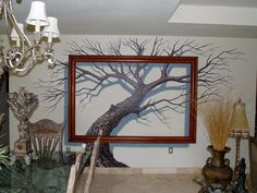 Rare and interesting mural, the painted tree and real frame produces an incredible 3D effect.